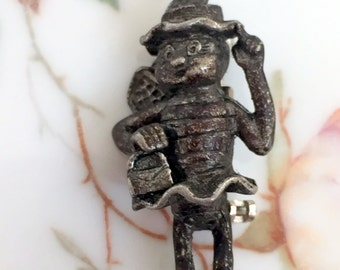 Vintage Bee scatter pin wearing a dress ,hat and carrying a purse Pewter