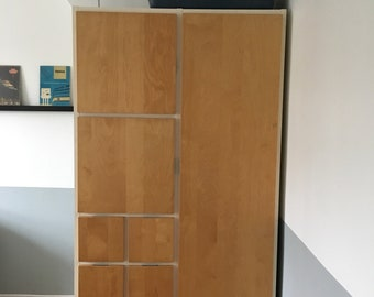 Wooden Tallboy storage with drawers and wardrobe