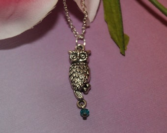 Beautiful antique silver owl pendant on a  sterling silver necklace with a single Aqua Swarovski crystal