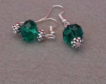 Czech emerald green glass bead with silver tone beads