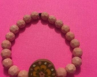 Light pink charm bracelet