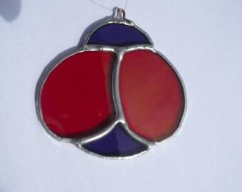 Purple Ladybug Sun Catcher / in a dark red