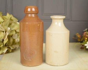Pair of antique stoneware bottles made in England, 1 x brown and 1 x cream colour
