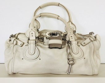 Pre owned Authentic CHLOE Paddington medium model handbag in off white grained leather.