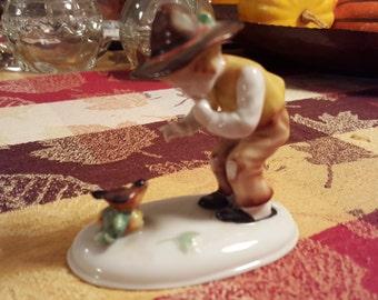 Charming Germany Figurine of Boy and Bird