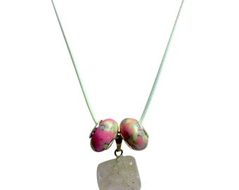 White Translucent Healing Stone  with 2 pretty pink and white beads on white cord