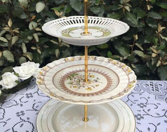 Vintage 3 tier cake plate stand.  mismatch green yellow and gold theme. Tea party. Wedding. Mad hatter. Baby shower. up cycled.