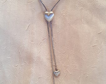Bolo style necklace...silver with 3 hearts.