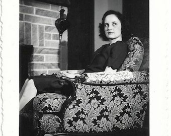 Old Photo Woman looks up sitting in Chair near Fireplace 1940s Photograph Snapshot vintage + Negatve
