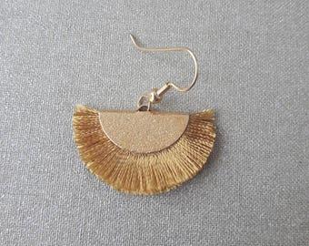Earrings range from light mustard rayon thread