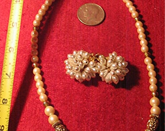 Ladies beaded jewelry set; pink, gold, & white necklace and white pearled earrings.
