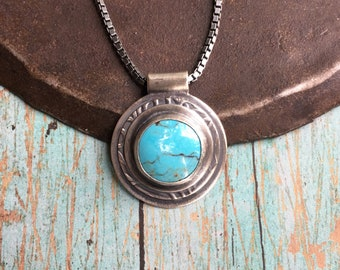 courage.  turquoise necklace