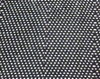 Wool with a fine black and white checkered pattern