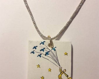 hand-painted ceramic necklace inspired by the