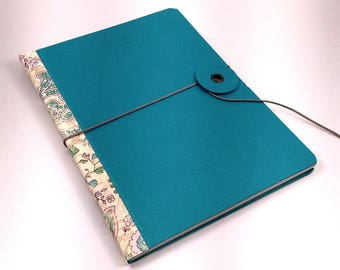 Pearly turquoise soft cover notepad with cashmere pattern on spine