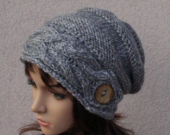 Hand knitted warm slouchy beanie. Soft and comfortable hat, for women perfect for colder seasons! Available in grey.