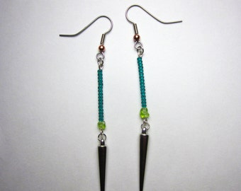Green seed bead dangle earrings with silver spike