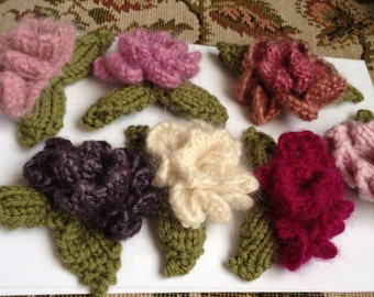 Hand knitted rosebud corsage