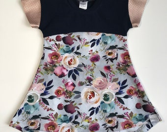Floral girls dress with curved high-low hem and faux leather cap sleeves