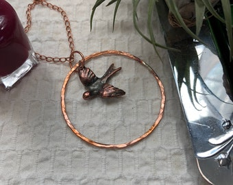 Iridescent Copper Swallow inside Copper Hoop