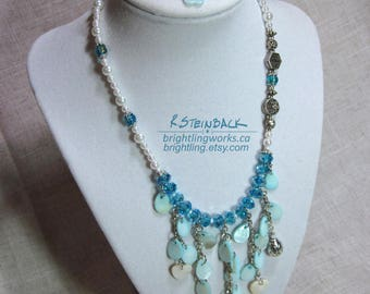 April Showers; Playful Faceted Blue Glass Bead and Chain Necklace; with Glass Pearls, Metal Flower Beads & Shell Drops with a Ladybug Accent