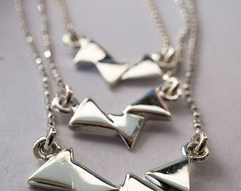 Ball chain necklace with triangles