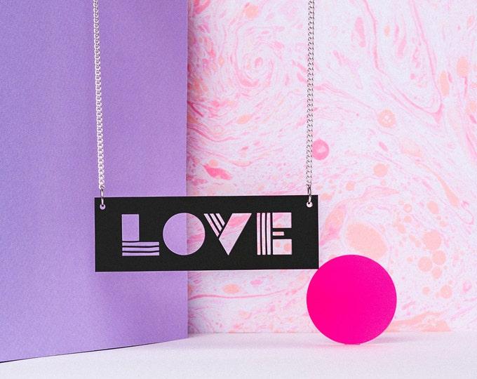 Graphic LOVE typographic black acrylic statement necklace