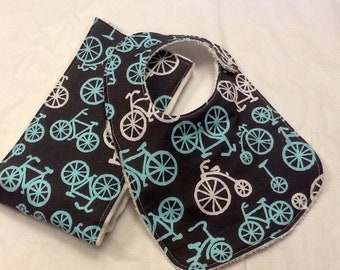 Baby bib and burp cloth set in Michael Miller bicycles in blue and gray