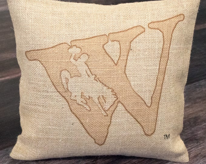 Featured listing image: Wyoming state brand bucking horse burlap throw pillow