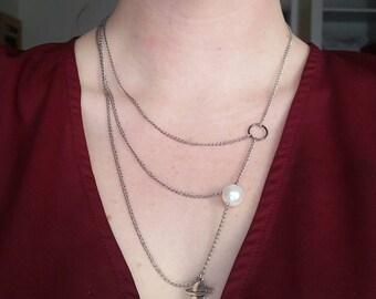 Asymmetrical galaxy necklace
