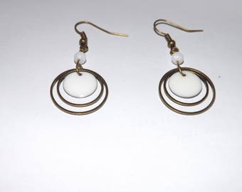 Bohemian, antique bronze round white epoxy enamel earring