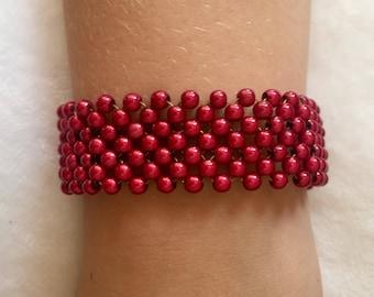 Red beaded bracelet with bronze fasten