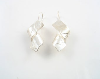Sterling silver twisted earrings, elegant yet every day earrings, casual,dangling, lightweight,textured and mat finish.