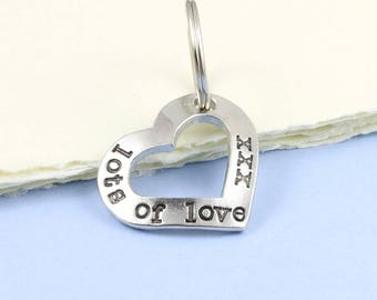 Open Heart Keyring Gift in Pewter with the message Lots of Love xxx hand stamped around it makes a great romantic gift, gift from boyfriend.