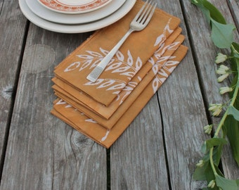 wheat lunch napkins. four