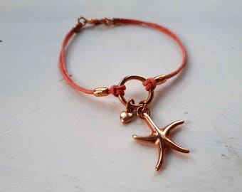 Wax cord bracelet with rose golden charms
