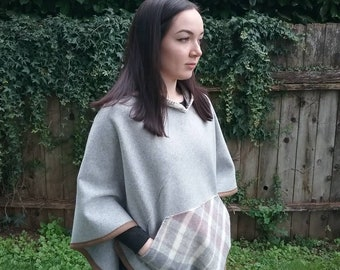 Hooded wool poncho  has a handy kangaroo pocket & fun fringed hood. Made completely  of wool from Pendleton.