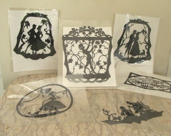 group of vintage 1920's paper silhouettes