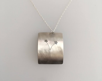 Sterling Silver cut-out flower pendant