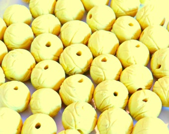 Yellow  swirl textured polymer clay beads