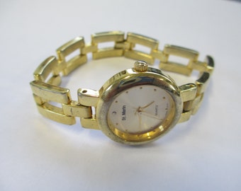 "Vintage ""  St Marin"" jewelry Ladies watch, gold segment band and gold tone face used good working condition"