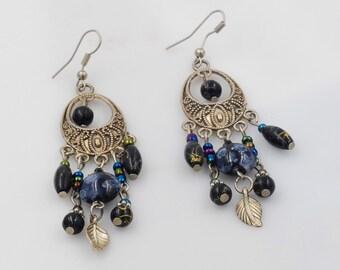 Pretty dangle blue glass bead silver toned filigree earrings.
