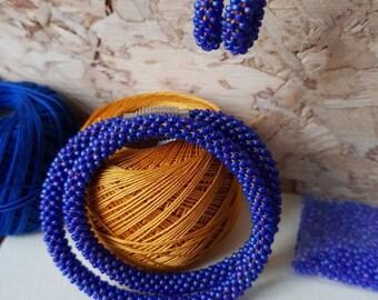 Blue dubbelwrap bracelet with matching earrings, crochet