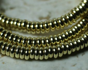 Gold tone rondelle beads aprox 4mm in diameter 1.5mm thick 2mm hole size, select your amount (item ID FA2464MB)
