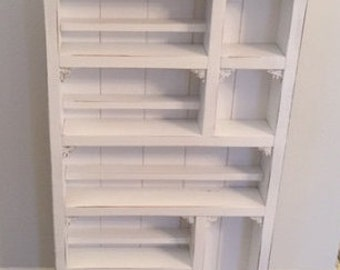 Essential oil shelf with nooks and crannies