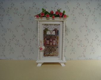 A Rose decorated bathroom cabinet.