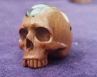 Wooden skull with a stone brain.