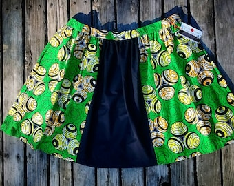 2X. African wax fabric women's skirt with pockets and zipper in fair trade fabric. Knee length. Green, yellow, and black marbles print.