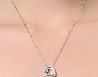 Unusual Heart Pendant hangs at an angle and has a tiny movable heart inside. A Romantic Gift for Valentine's Day