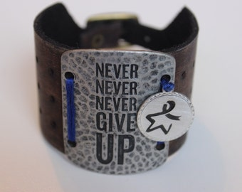Never Give Up Colon Cancer Awareness Bracelet: leather cuff, metal plate, hand-stamped charm with the 'symbol of hope' colon cancer logo